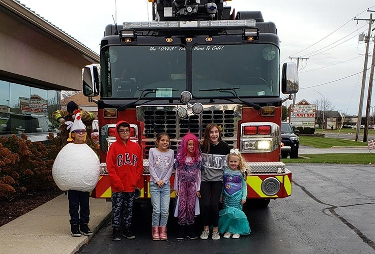Kids in front of fire truck