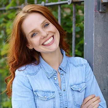 Woman sharing aligned smile after Invisalign