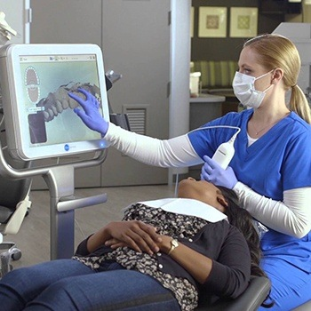 Dentist scanning smile during Invisalign treatment planning