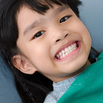 Child smiling during dental checkup